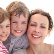 Happy family with mother, daughter and son smiling and looking a — Stock Photo