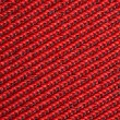 Red textural fabric, pattern on diagonal — Stock Photo #7938012