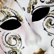 White Venetian mask with patterns, Lying on diagonal - Stock Photo