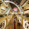 Stock Photo: Modern shopping center interior at night. Big floor spaces, esca