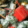 Celebratory gifts in red small boxes hanging on Christmas fur-tr — Stock Photo #7938218