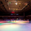 Big covered skating rink with multi-coloured illumination in spo — Stock Photo #7938253