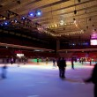 Big covered skating rink with multi-coloured illumination in spo — Stock Photo #7938259