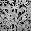 Lace doily on black background — Stock Photo