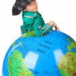 Boy in historical dress leans on inflatable globe isolated on wh - Foto de Stock