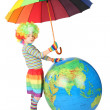 Boy in clown dress with umbrella and big globe isolated on white - Stockfoto