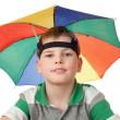 Boy with multi-coloured umbrella on head isolated on white backg — Stock Photo #7938826