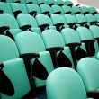 Stock Photo: Fragment of empty conference hall, rows of a chairs