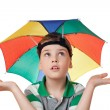 Boy with multi-coloured umbrella on head spread his hands aside — Stock Photo