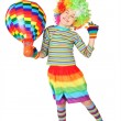 Boy in clown dress with multicolored hot-air balloon standing is - Stock Photo