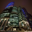 Stock Photo: Modern office building at night, skyscraper in moscow, foreshort