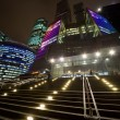 Stock Photo: Facade of modern office building at night, skyscraper in moscow,