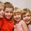 Laughing children four together in cosy room, two pretty girls a — Stock Photo #7939032