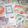 Background from banknotes of various monetary currencies - Foto Stock