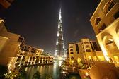 Burj Dubai skyscraper and yellow buildings general view, Dubai, — Stock Photo