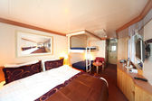 Ship cabin with big double bed and two children beds general vie — Stock Photo