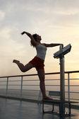 Girl practise gymnastics exercises at ship deck full body — Stock Photo