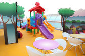 Little boy slide on bright colorful children's playground on cru — Stok fotoğraf