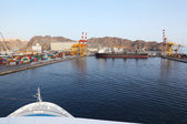 Big black tanker loading in dock view from cruise ship — Stock Photo