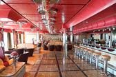 Cafe with bright multicolored interior, bar and red celling gene — Stock Photo