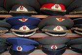 Ussr polisman uniform hats with visor on wooden shelf — Stock Photo