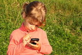 Little girl with communicator — Stock Photo
