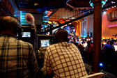 Two video operators controlling camera at performance show — Stockfoto