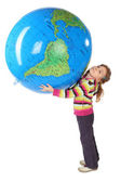 Little girl standing and holding big inflatable globe over her h — Stock Photo