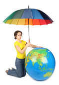 Beauty woman sitting and holding umbrella under big inflatable g — Stock Photo