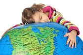 Little girl lies on big inflatable globe and embracing it, eyes — Stock Photo