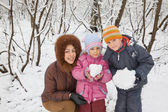 Young woman with boy and little girl in winter in wood, children — Stock Photo
