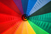 Open multi-colored umbrella shot closeup — Stock Photo