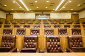 Conference halls with magnificent leather armchairs and wooden t — Stock Photo