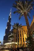 DUBAI - APRIL 18: Burj Dubai skyscraper and street with decored — Stock Photo