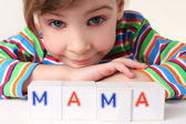"Little girl plays with cubes and puts it together in word ""mothe — Stock Photo"