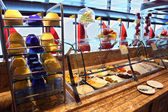 Showcase with food and tableware in dinning room on cruise liner — Stock Photo