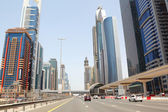 DUBAI - APRIL 18: general view on trunk road and skyscrapers on — Stock Photo