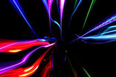 Abstract background with multicolored motion blured lines on bla — Stock Photo