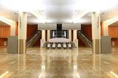Big modern hall with granite floor, columns and two escalators i — Stock Photo