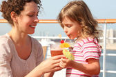 Mother and daughter standing on cruise liner deck, mother holdin — Stock Photo