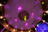 Circus interior view on celling with pink light lamps and blue c — Stock Photo