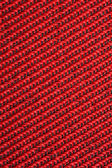 Red textural fabric, pattern on diagonal — Stock Photo