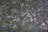 Grey school chalkboard with many different formuls, signs and co — Stock Photo
