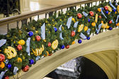 Christmas ornaments attached to handrail in shopping centre — Stock Photo