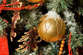 Christmas toy in form of sphere hanging on artificial fur-tree, — Stock Photo