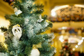 Christmas ornament in form of pigeons on fur-tree in shopping ce — Stock Photo