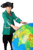 Little boy in historical dress looking at big inflatable globe i — Stock Photo