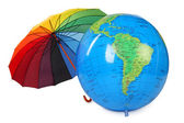 Big inflatable globe and colored umbrella isolated on white back — Stok fotoğraf