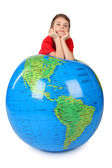 Boy in red shirt leans on inflatable globe chin on hands isolat — Stockfoto