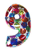 Colorful gelium balloon shape number nine for birthday celebrity — Stock Photo